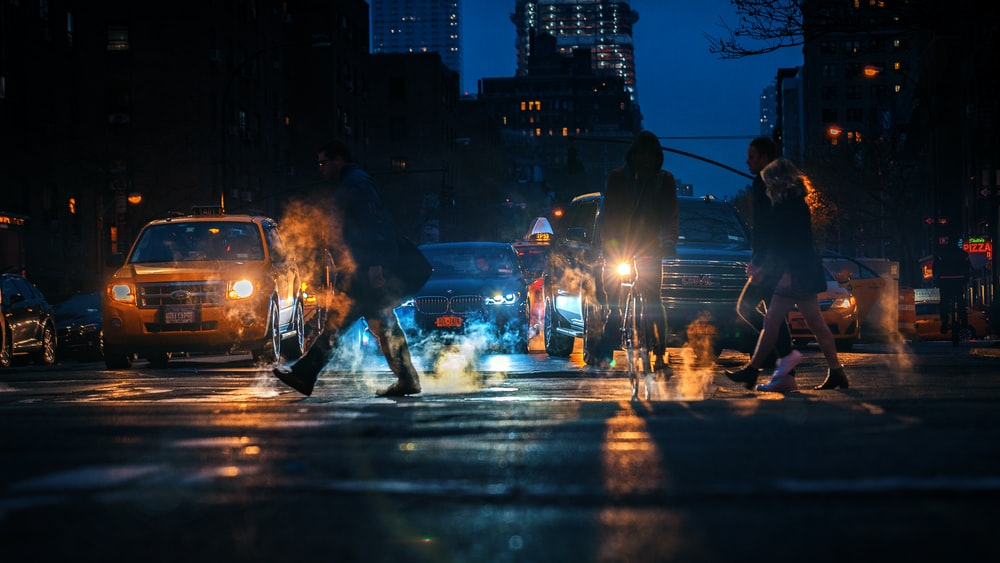 person walking on the street during night time