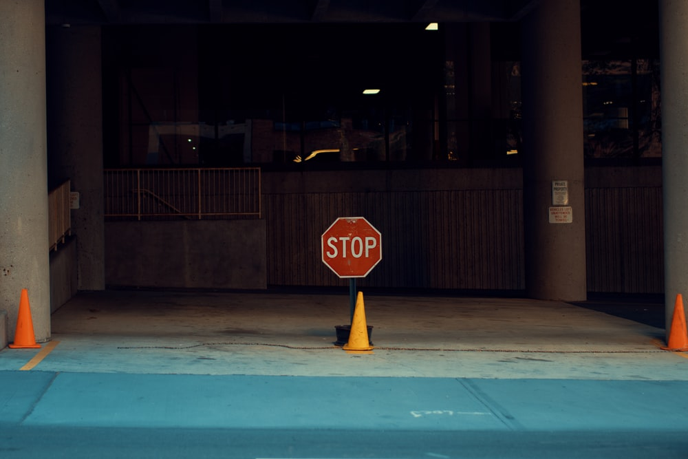 selective focus photography of stop signage