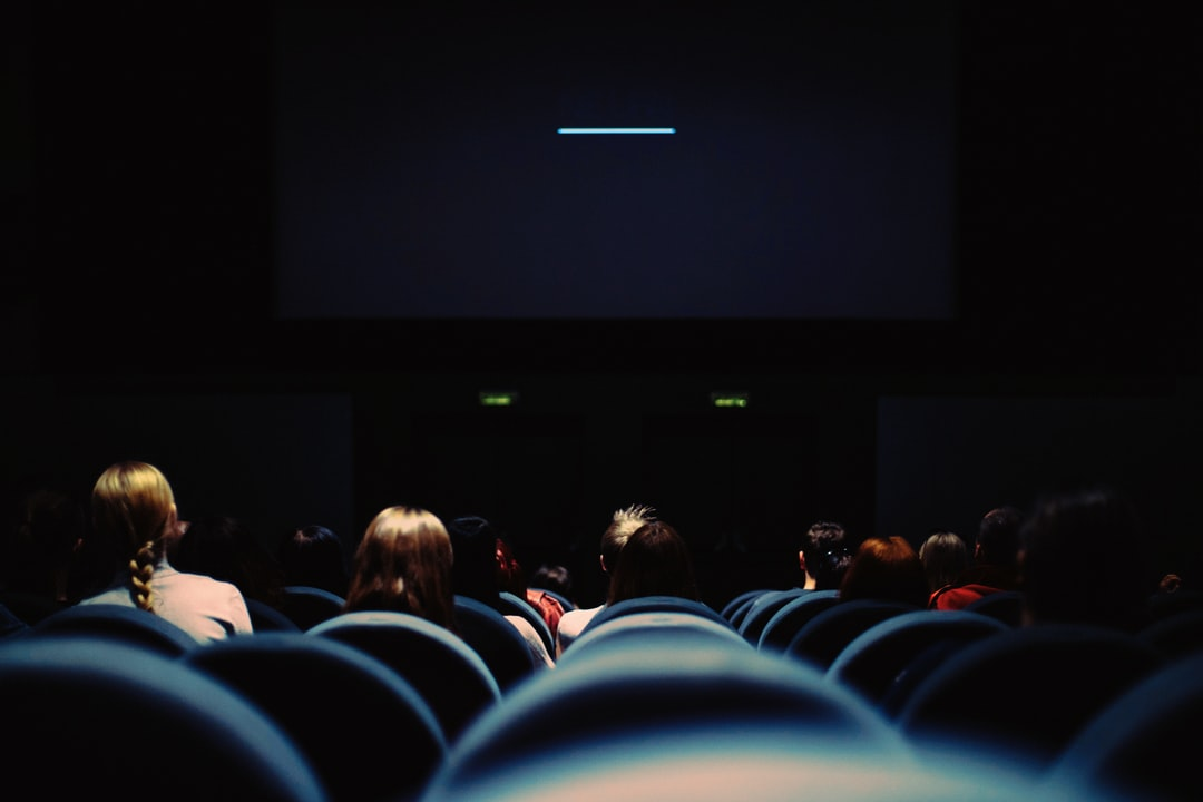 I love this time at the theater, the minutes of waiting for the film to begin and the crowd sits with anticipation, the smell of popcorn fills the air and the soft chattering of friends make the soundtrack of the evening worthy of the film to come.