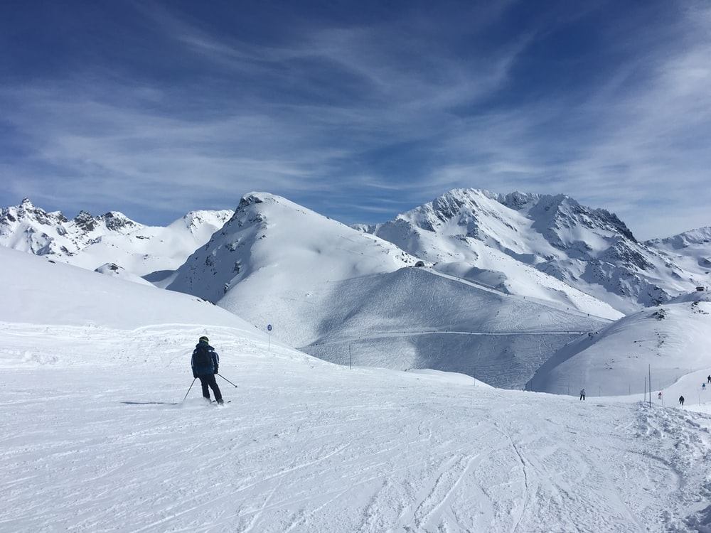 person skiing on snowy mountain