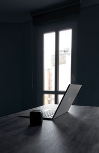 silver laptop computer and black camera lens