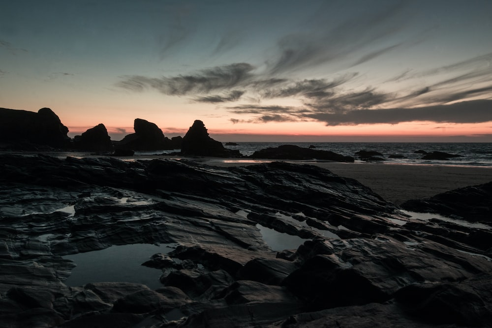 rock formation near the ocean during golden hour photography