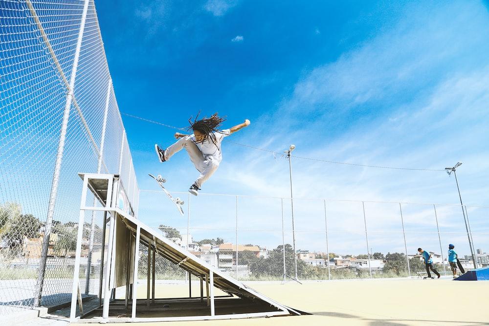 man doing skateboard trick on ramp during daytime