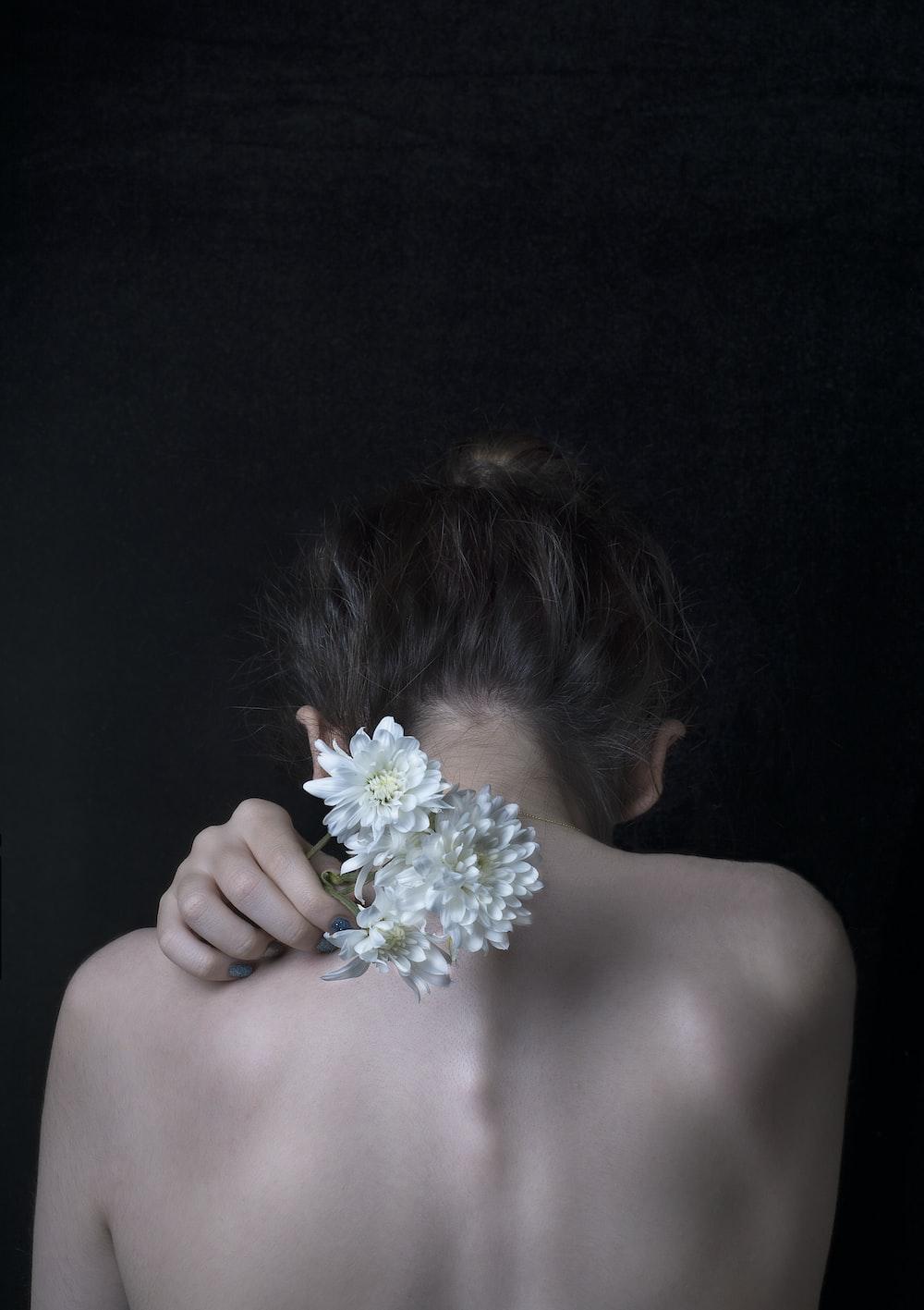 woman holding flower