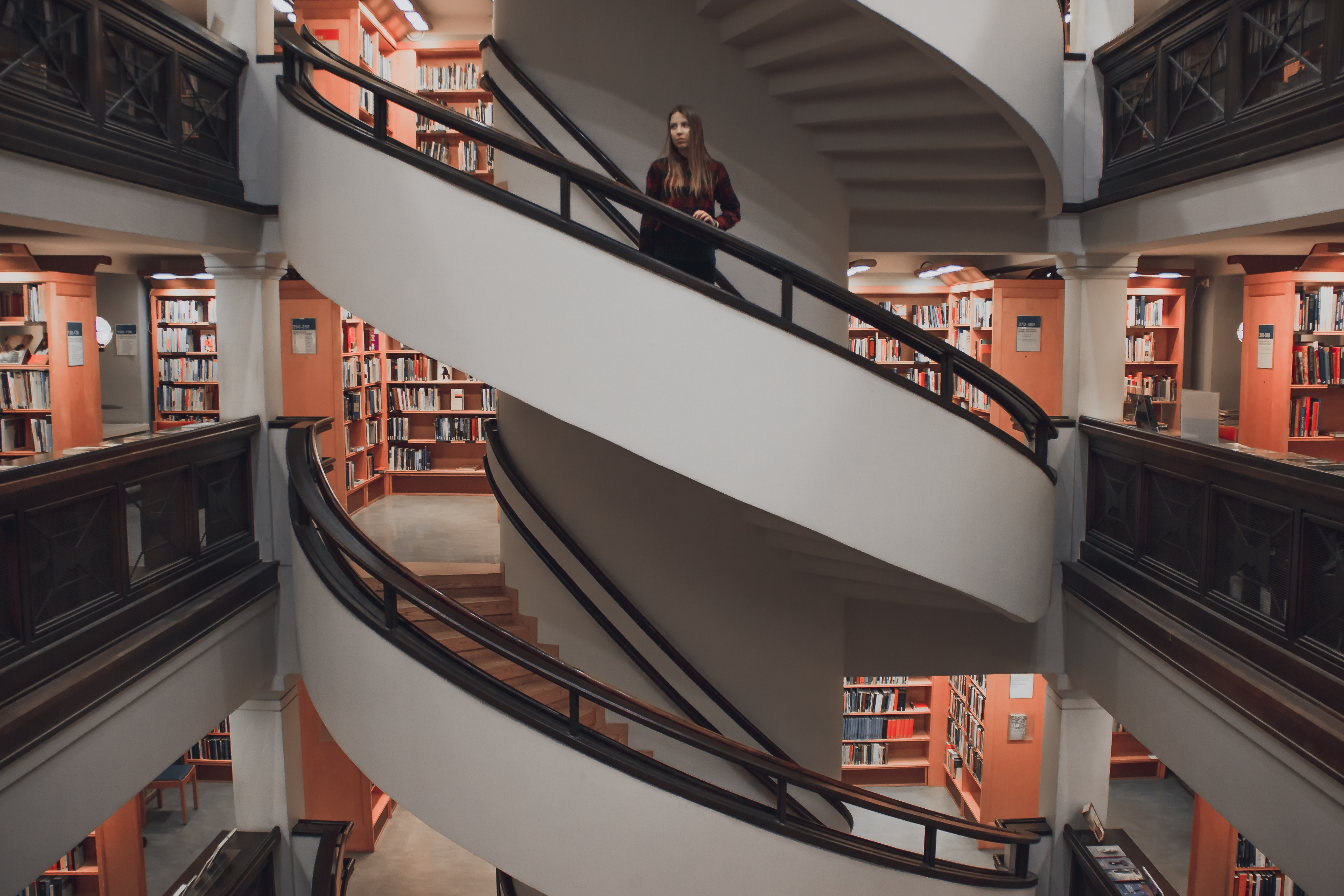 woman standing on spiral stairway