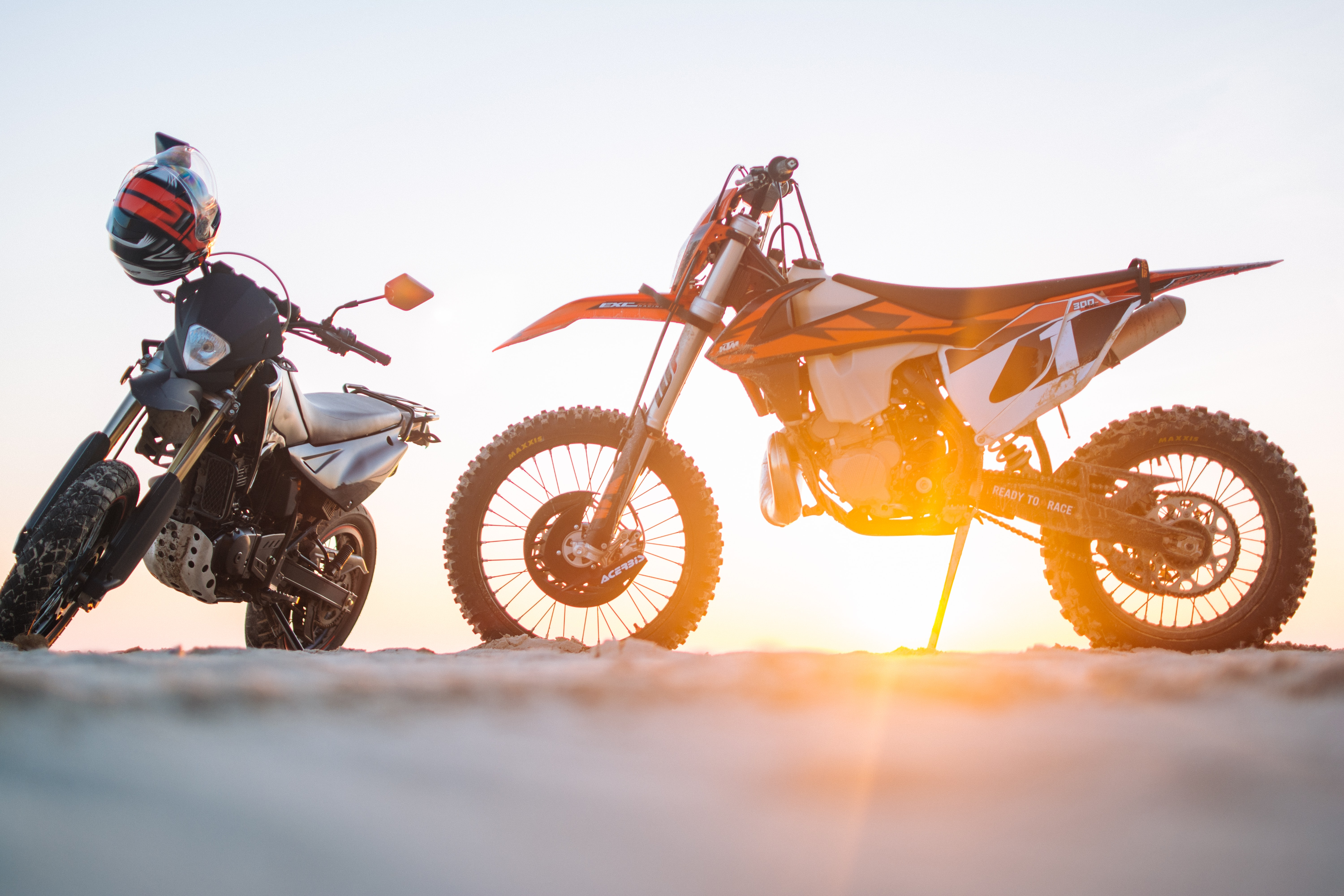 two black and orange dual motor sports on ground
