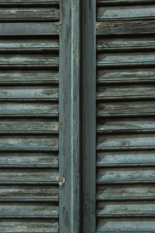 blue wooden door with gray steel door lever