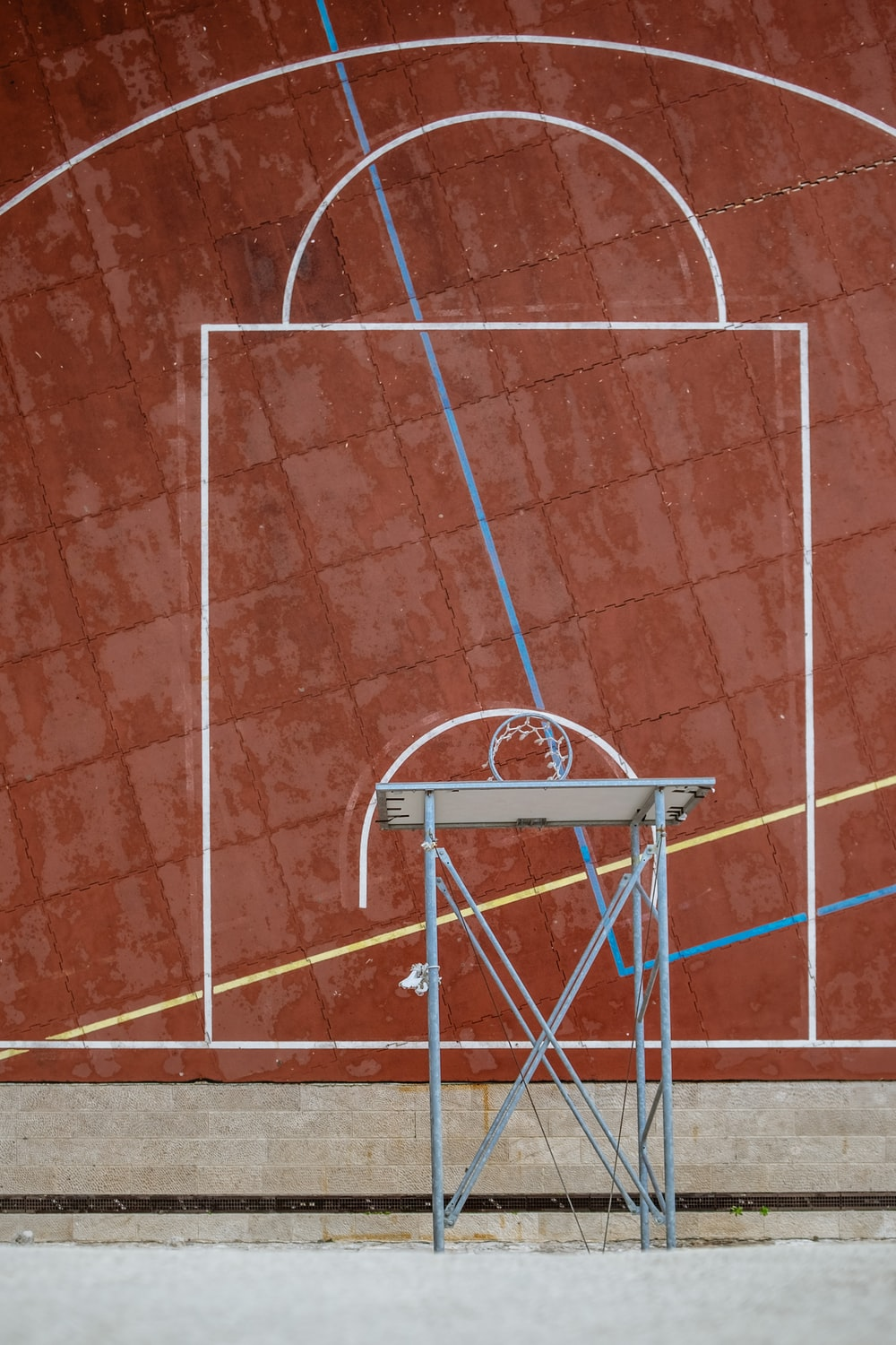top view photography of white and gray basketball hoop and court