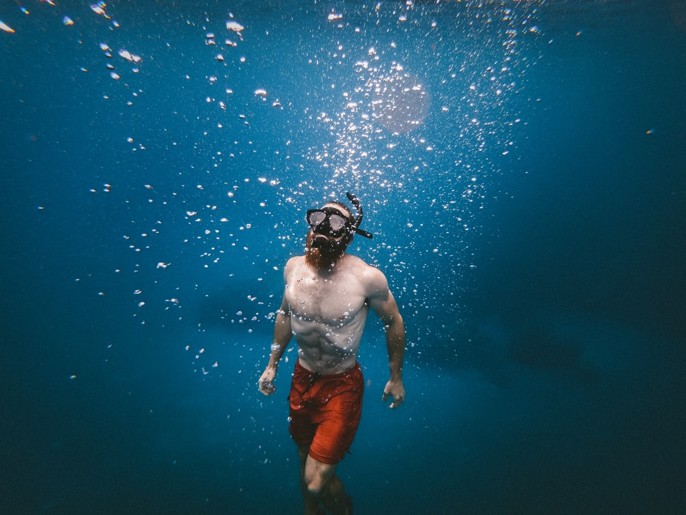 man in body of water