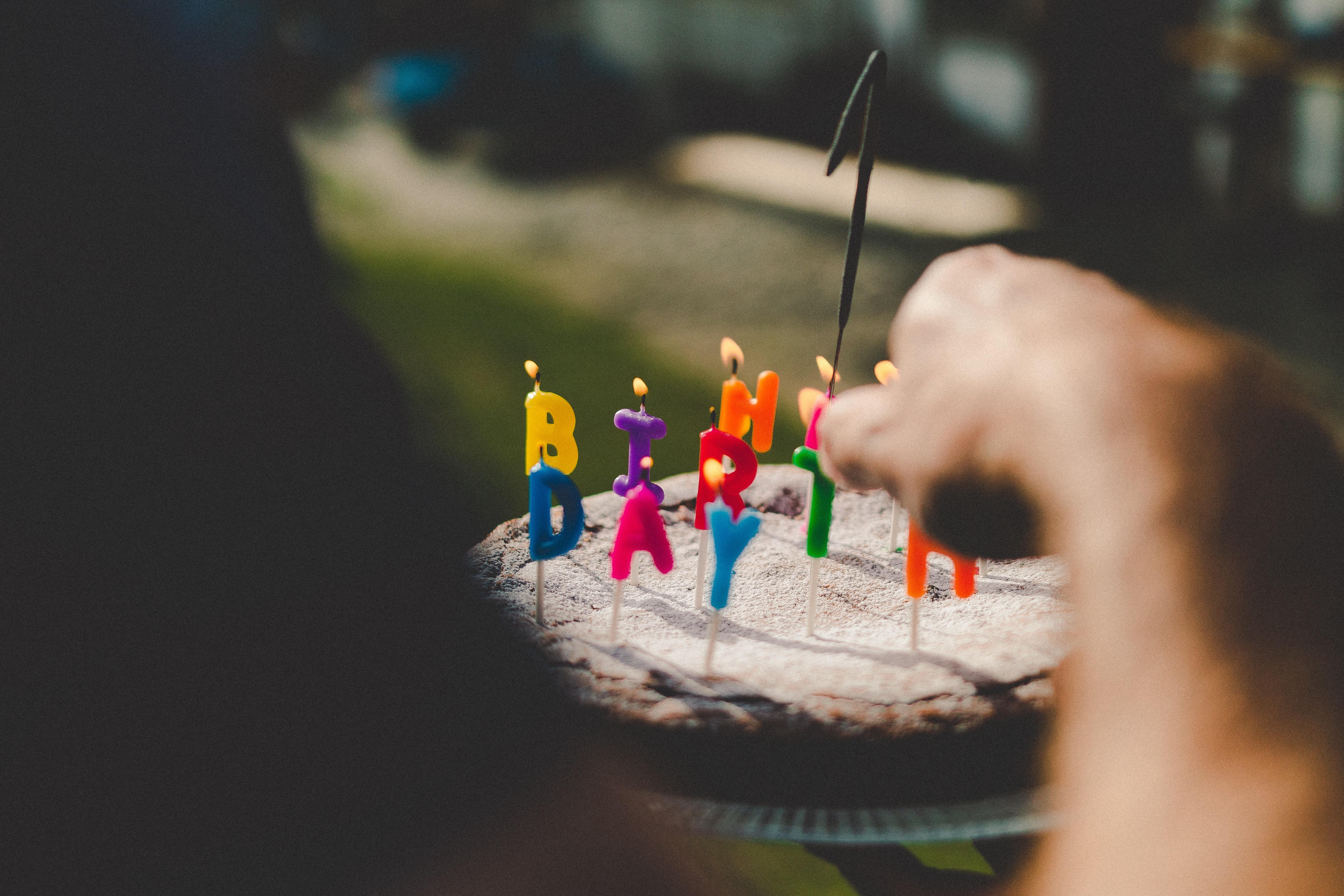 person holding birthday cake
