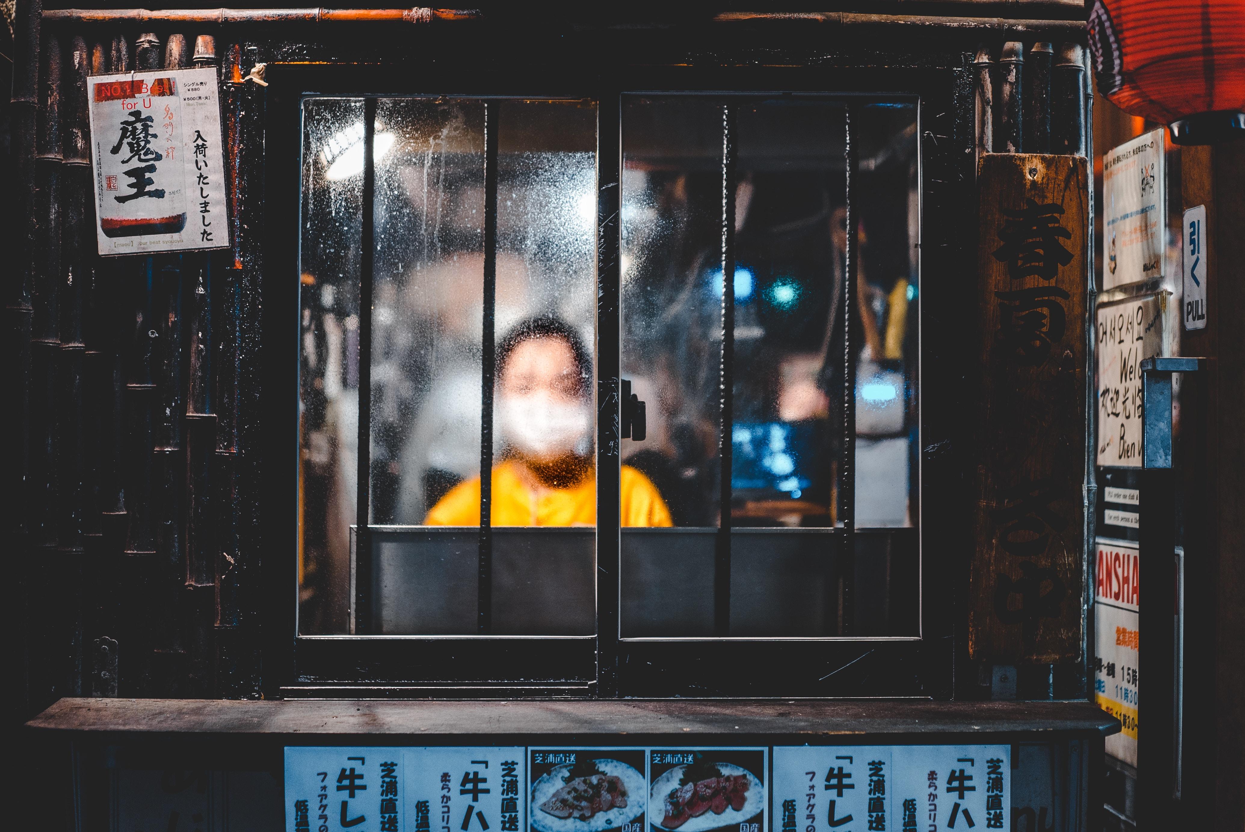 boy standing in front of window