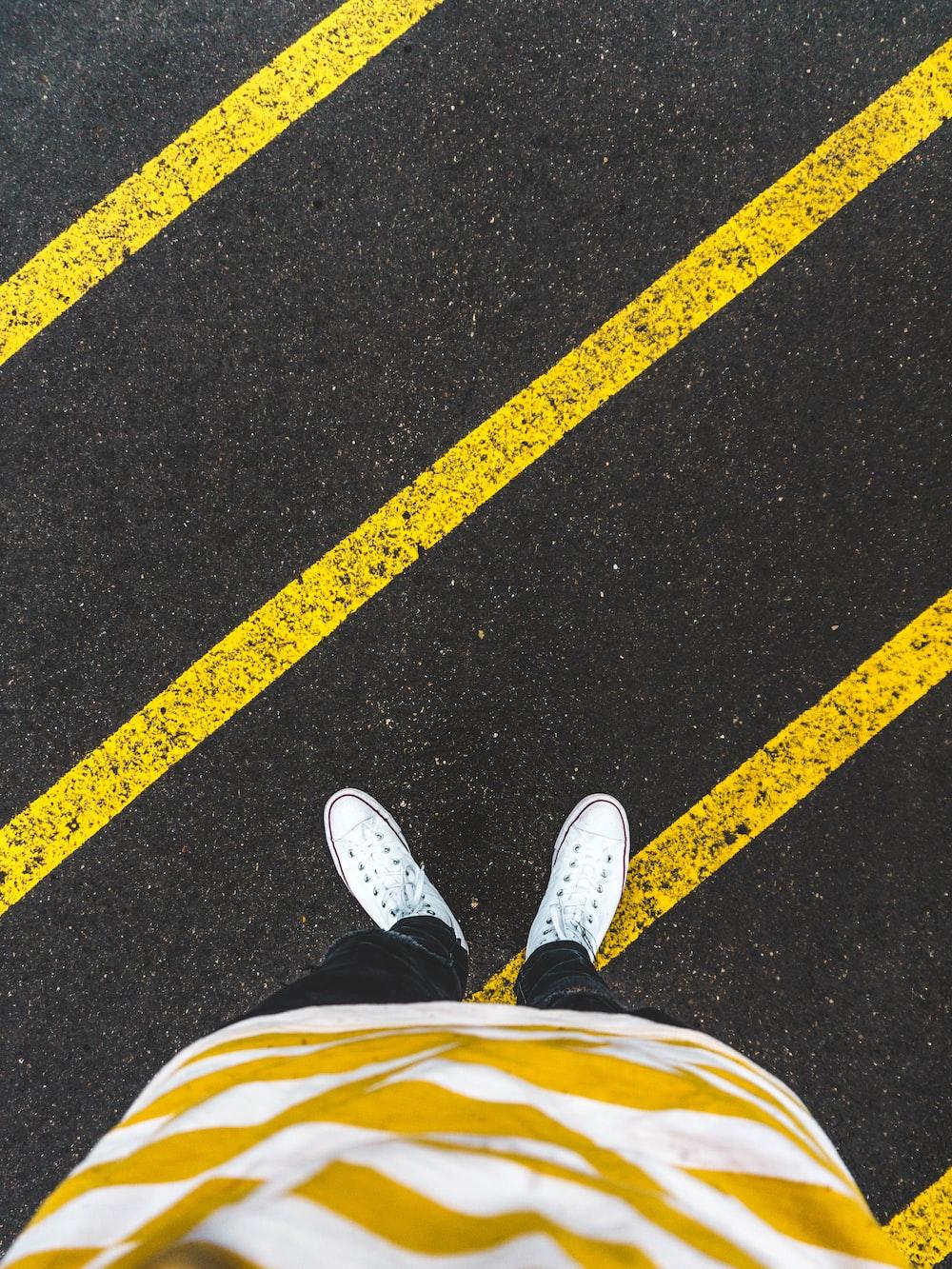 person standing on pedestrian lane