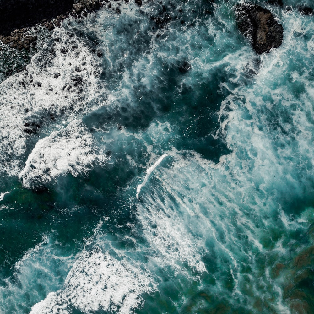 sea waves hitting rocky shores