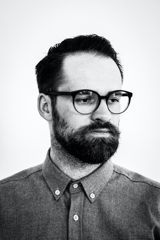 grayscale photo of man wearing button-down dress shirt