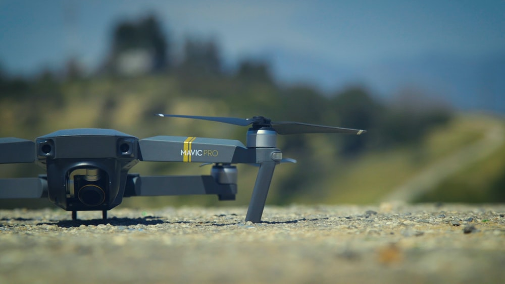 selective focus photography of DJI Mavic Pro drone on ground
