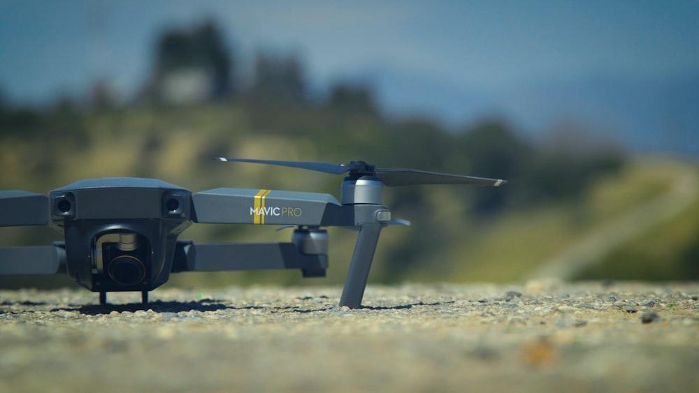 selective focus photography of DJI Mavic Pro drone on ground