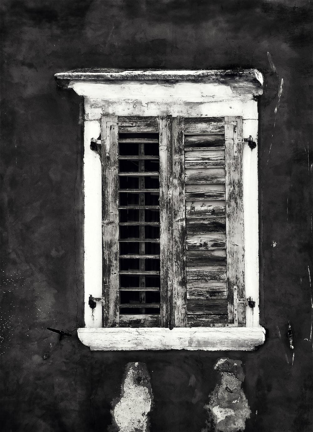grayscale photography of opened window