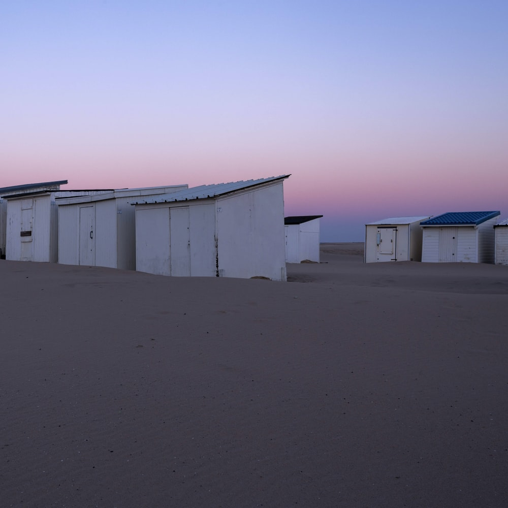 seven white wooden sheds