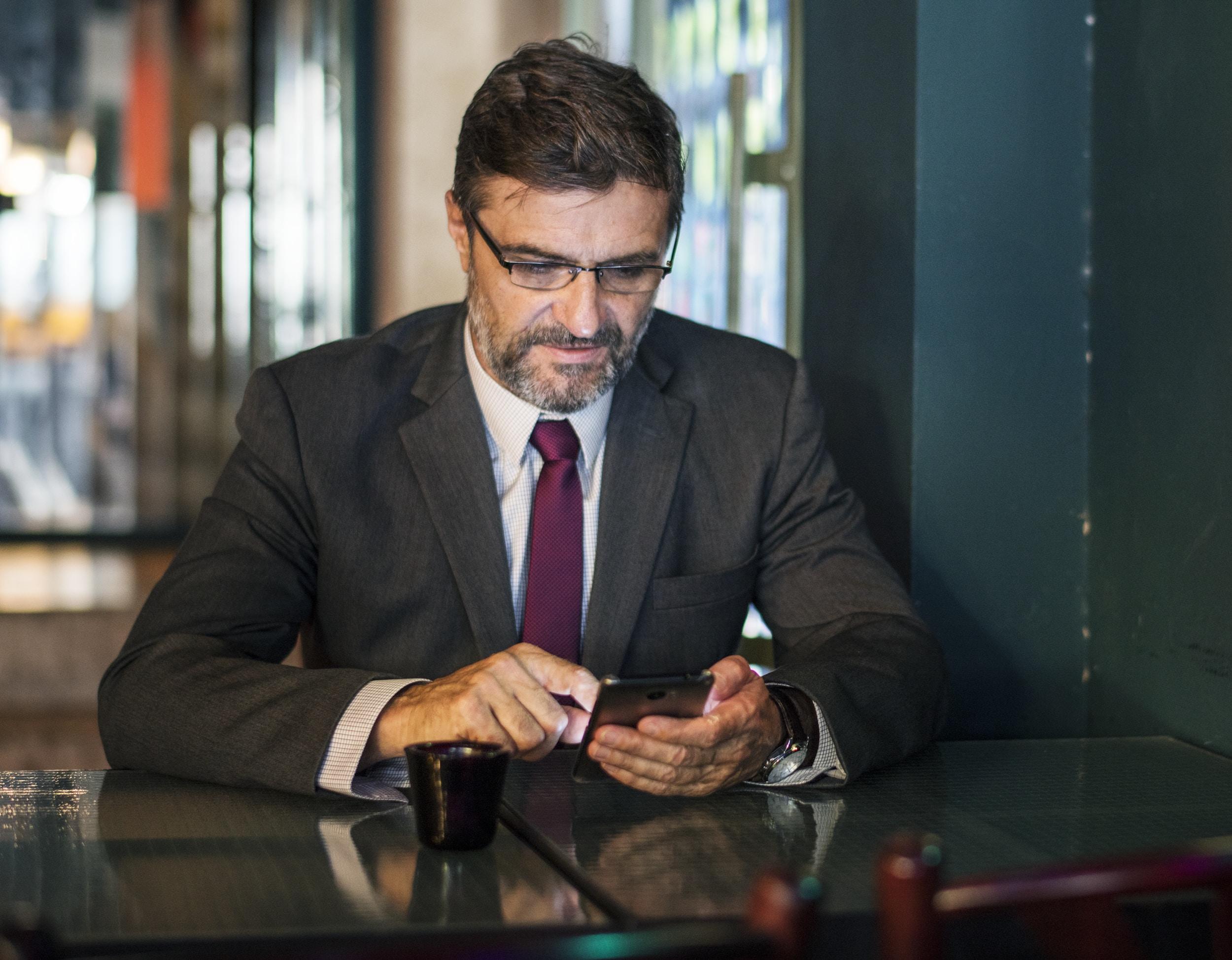 man sitting using smartphone
