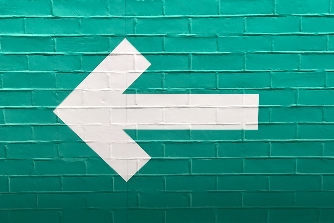 """""""Further to me posting a white arrow on a blue wall, pointing right, here is the other, a white arrow on a green wall, pointing left."""""""