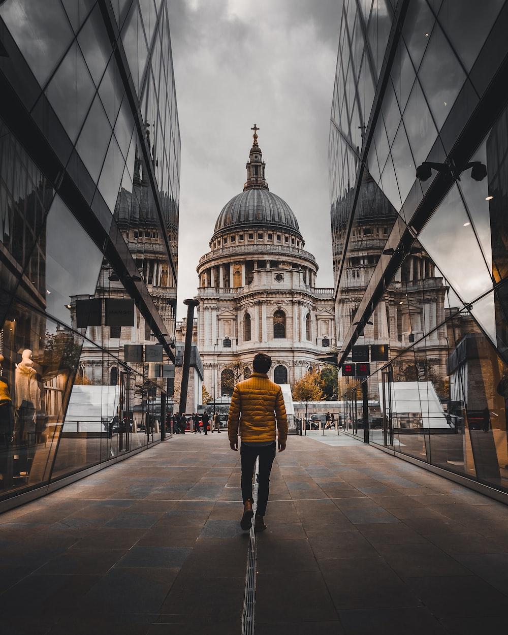 man standing between buildings during daytime