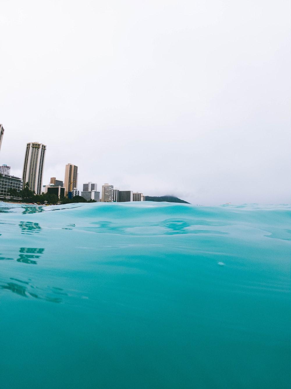 clear blue sea near high rise building