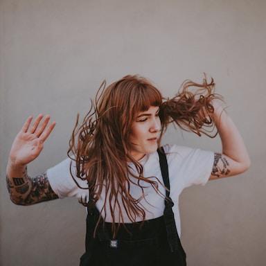 woman holding hair during daytime