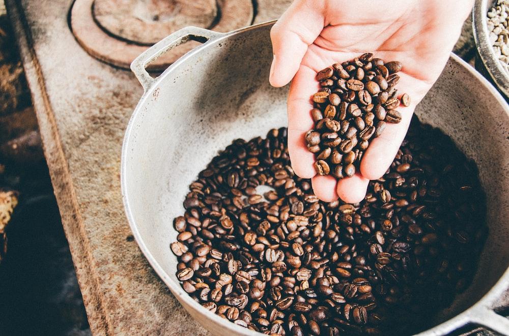 coffee beans on gray steel wok