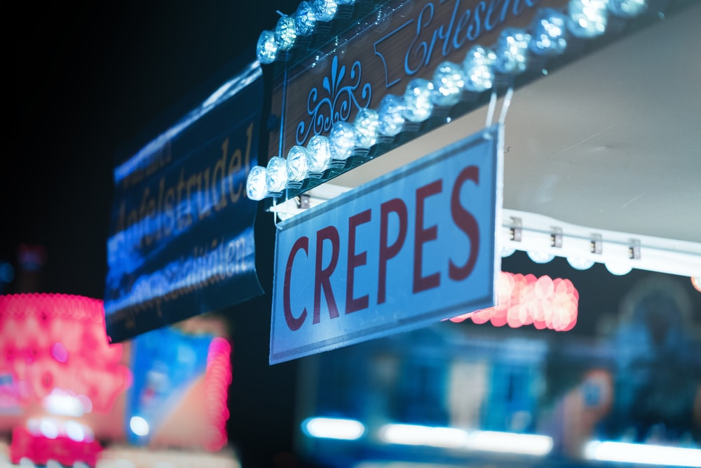 white and red Crepes signage