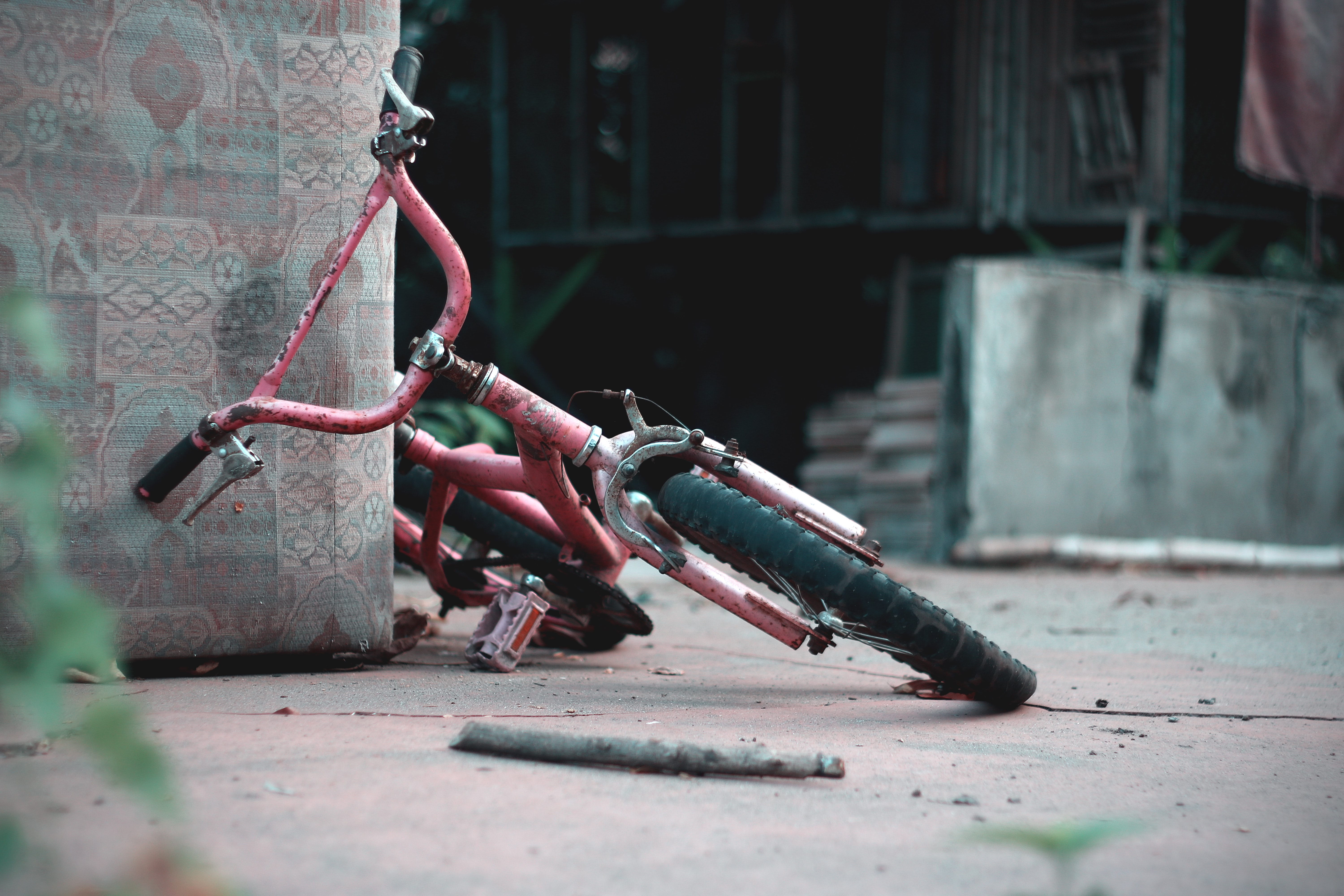pink bicycle on brown concrete floor