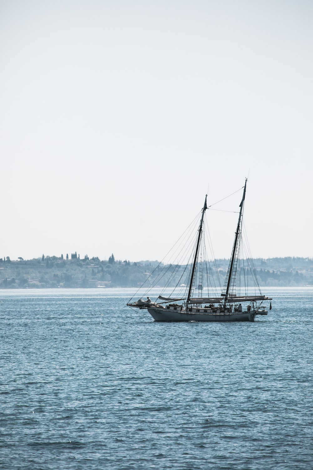 white ship sailing on body of water