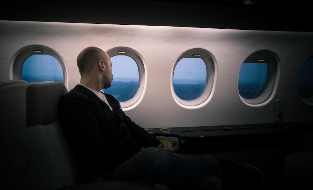 man seating near window