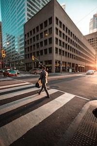 man crossing pedestrian lane