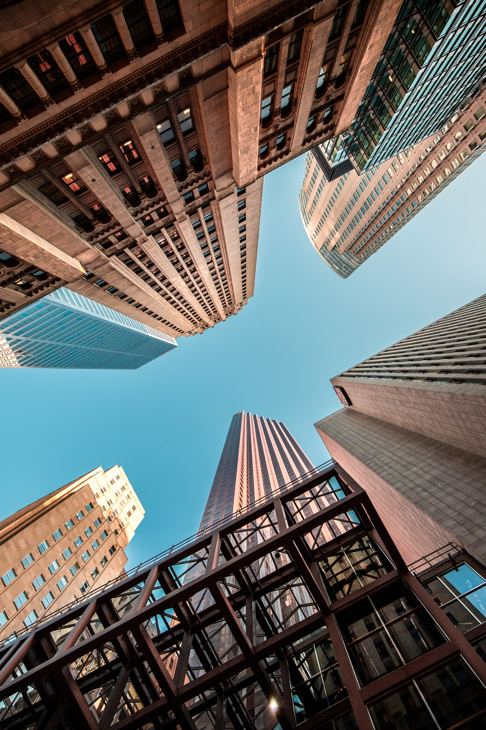 wormseye view of high-rise buildings under blue sky