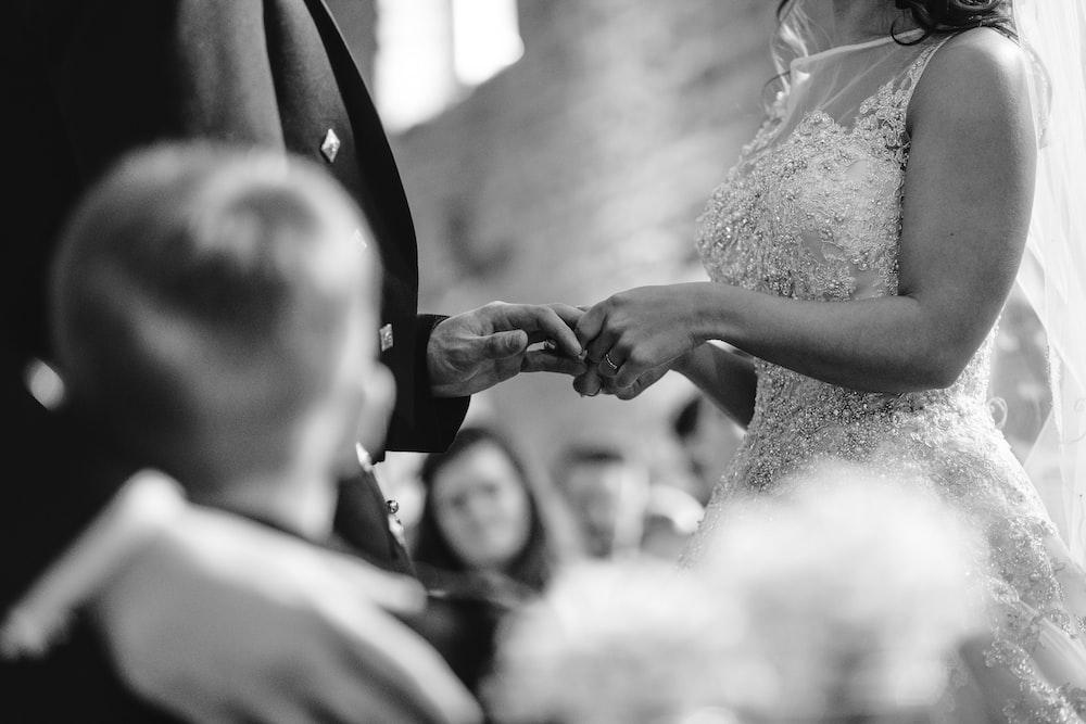 grayscaled photo of wedding