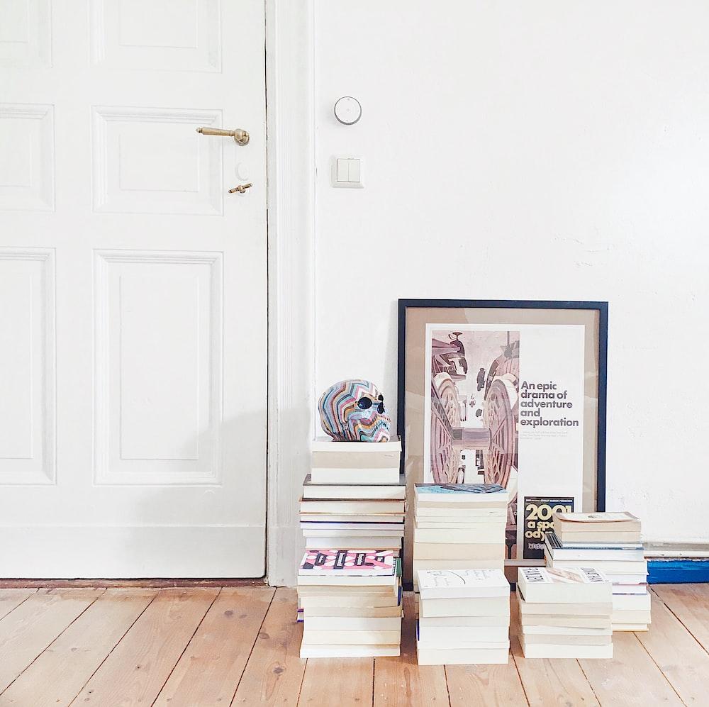 assorted books near door