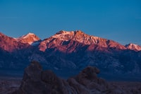 A faint chirping of birds begins as the sun peaks it's self over the distant mountains, for yet another day of beauty and tranquility in the desert. Just to the right sits Mt. Whitney, the tallest mountain in the contiguous US, in the Sierra Mountains.