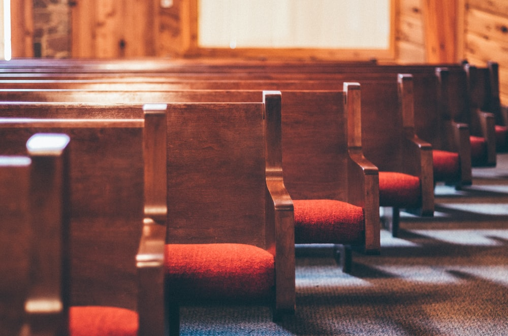lined brown pew benches