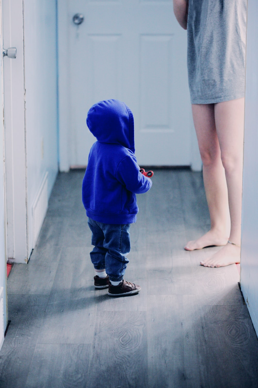 toddler in blue hooded jacket