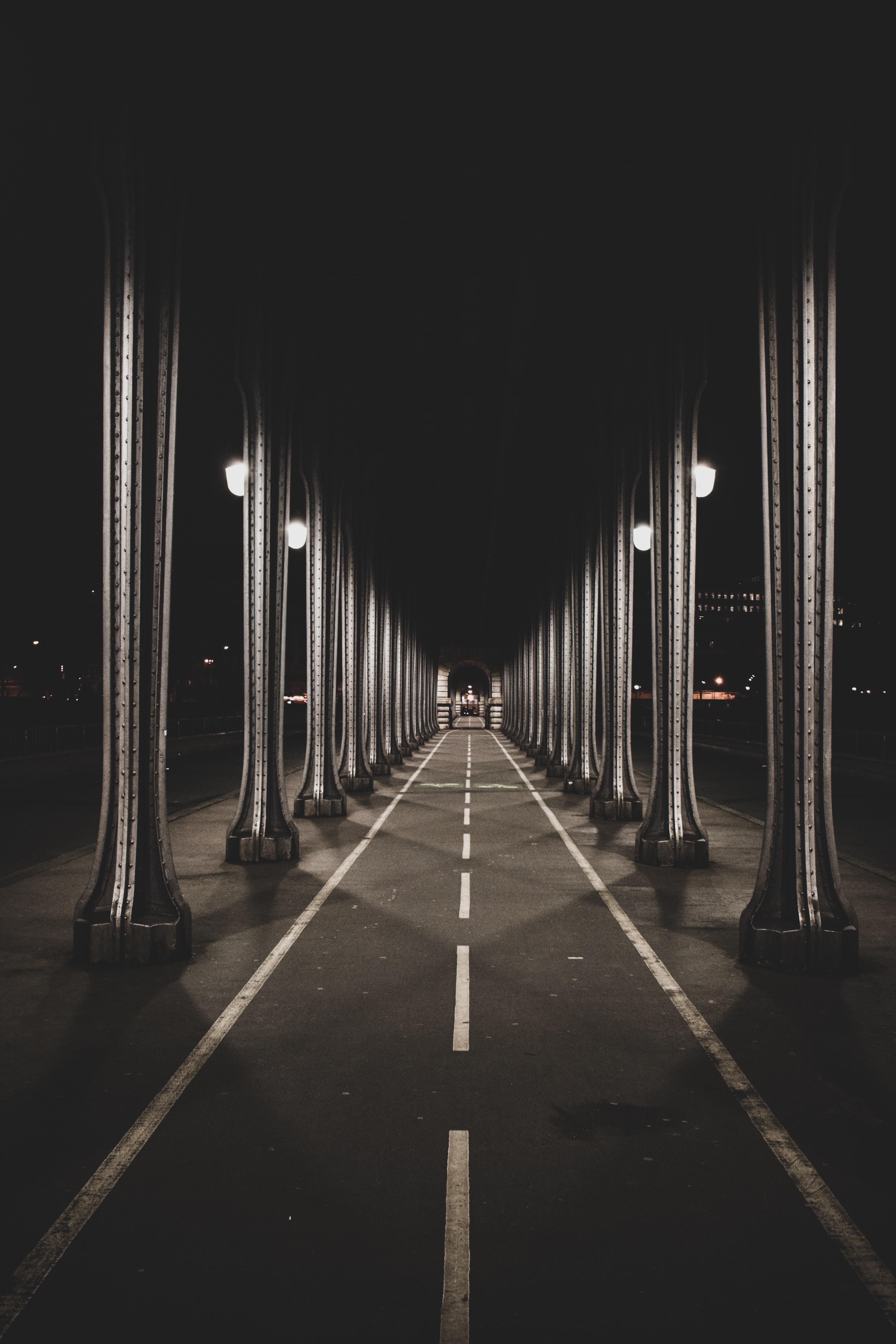 road under gray bridge