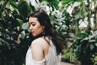 selective focus photography of woman in white top