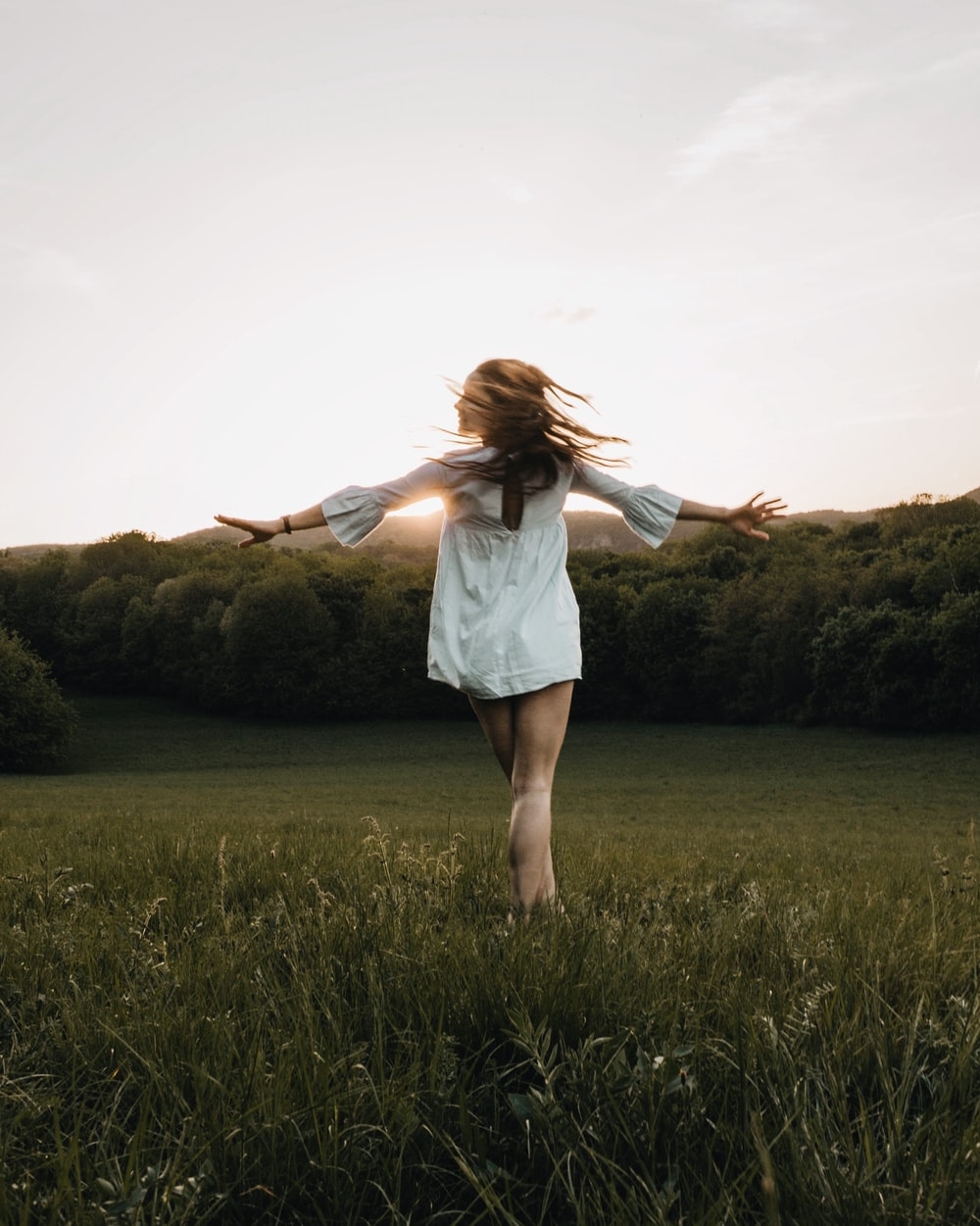 woman open arm on grass