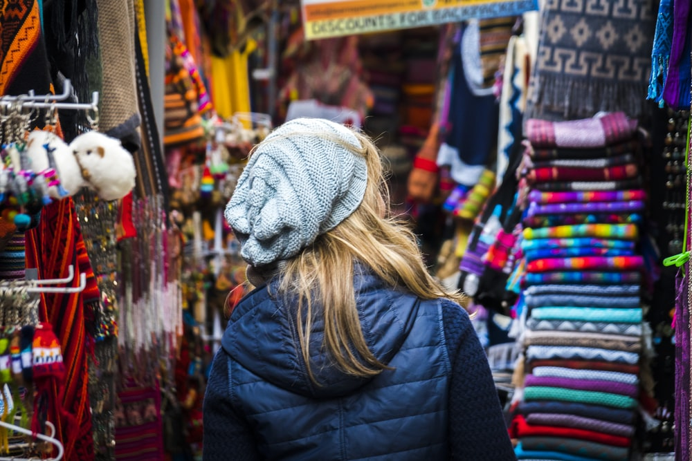 woman standing on clothes market