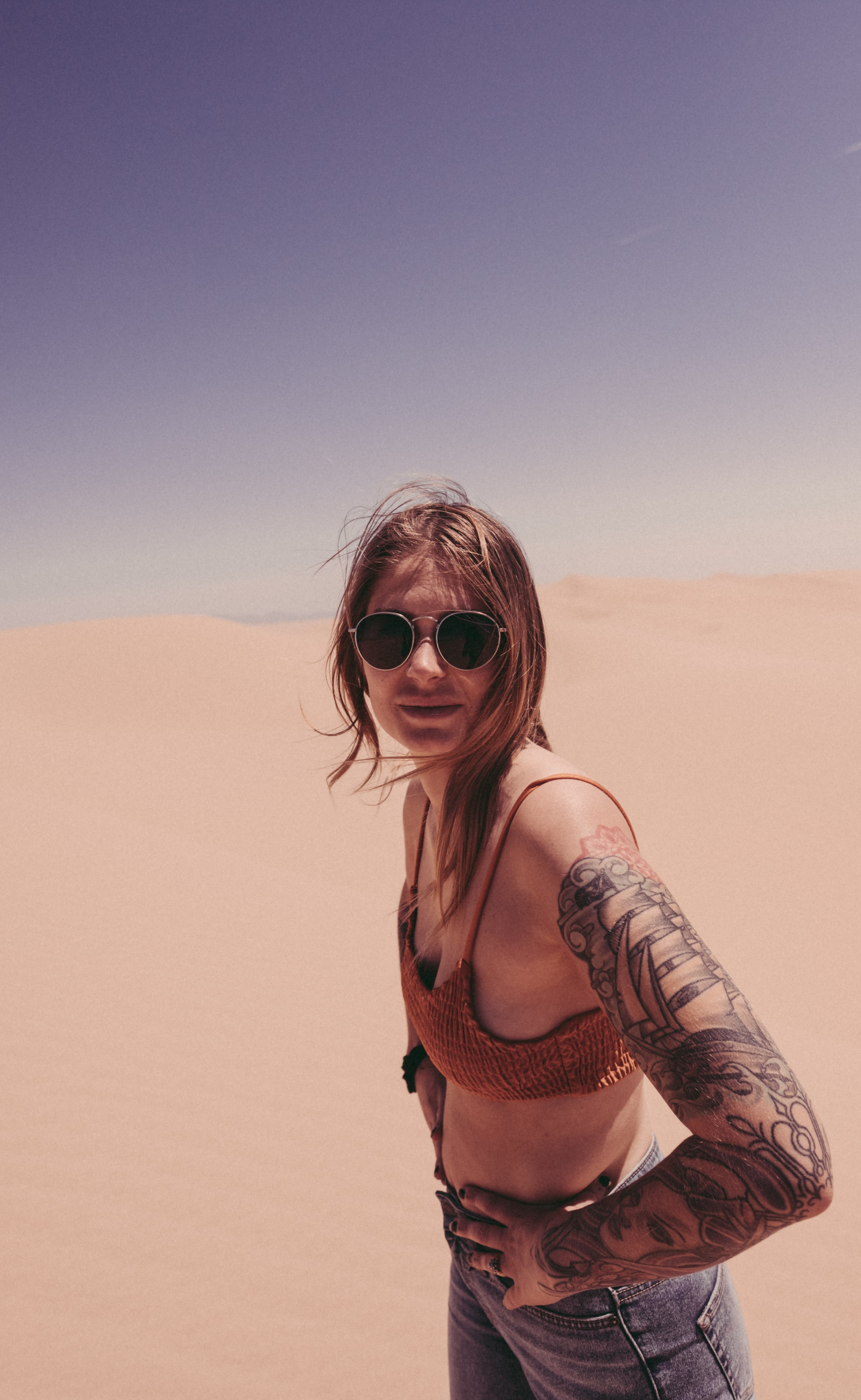 woman in knitted bra on desert