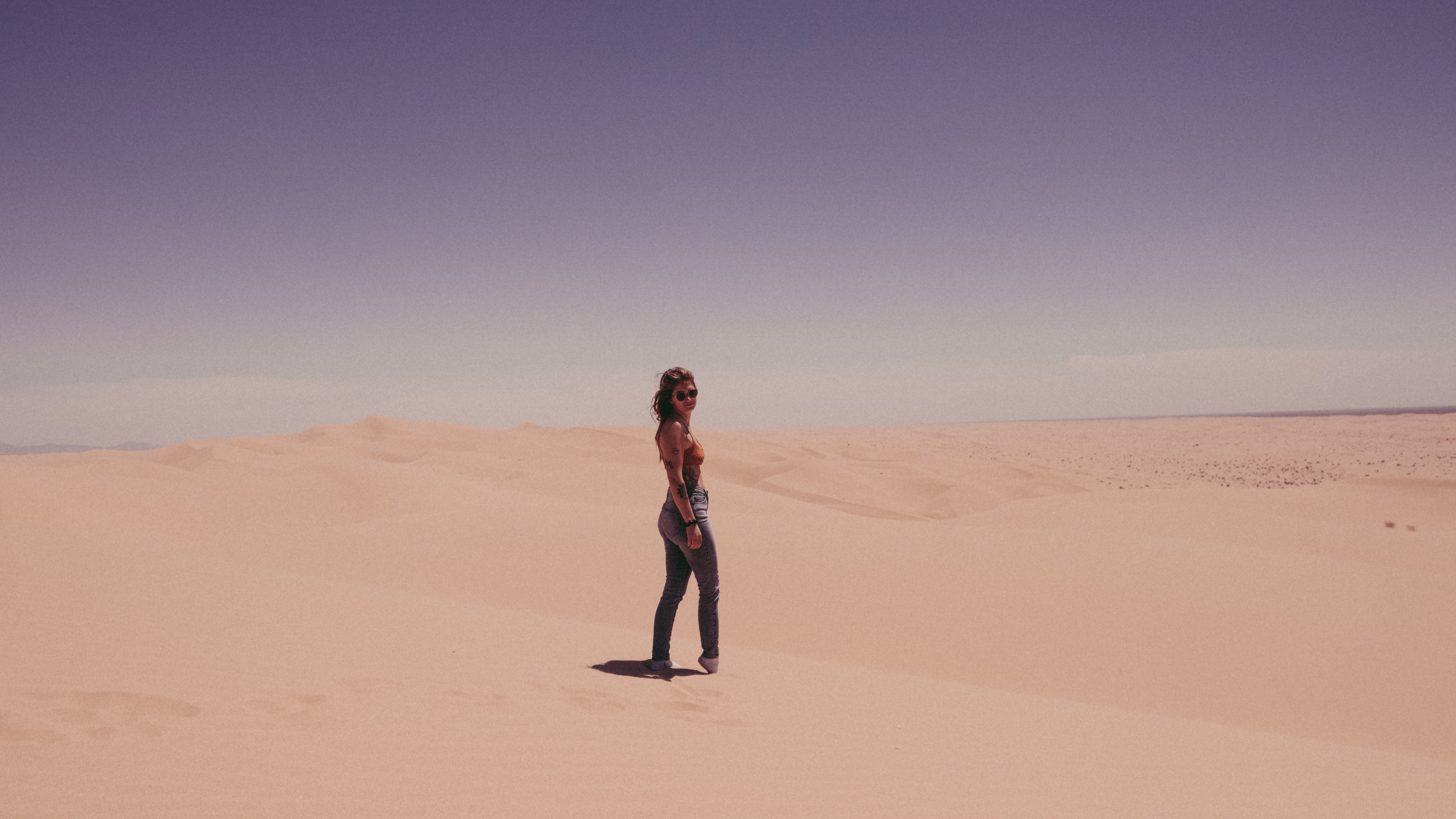 woman standing on sand during daytime