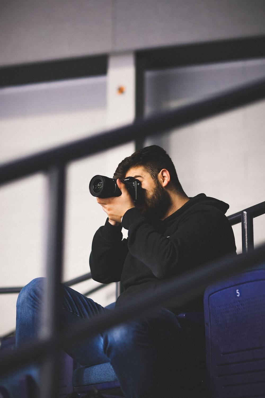 man taking photos