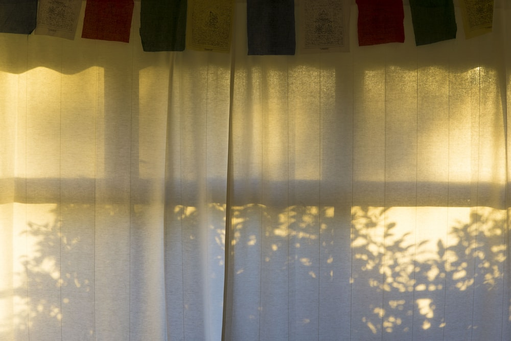 white curtain hanging on window