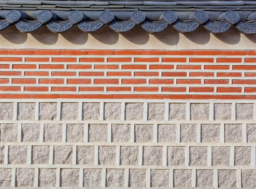 gray and brown wall bricks