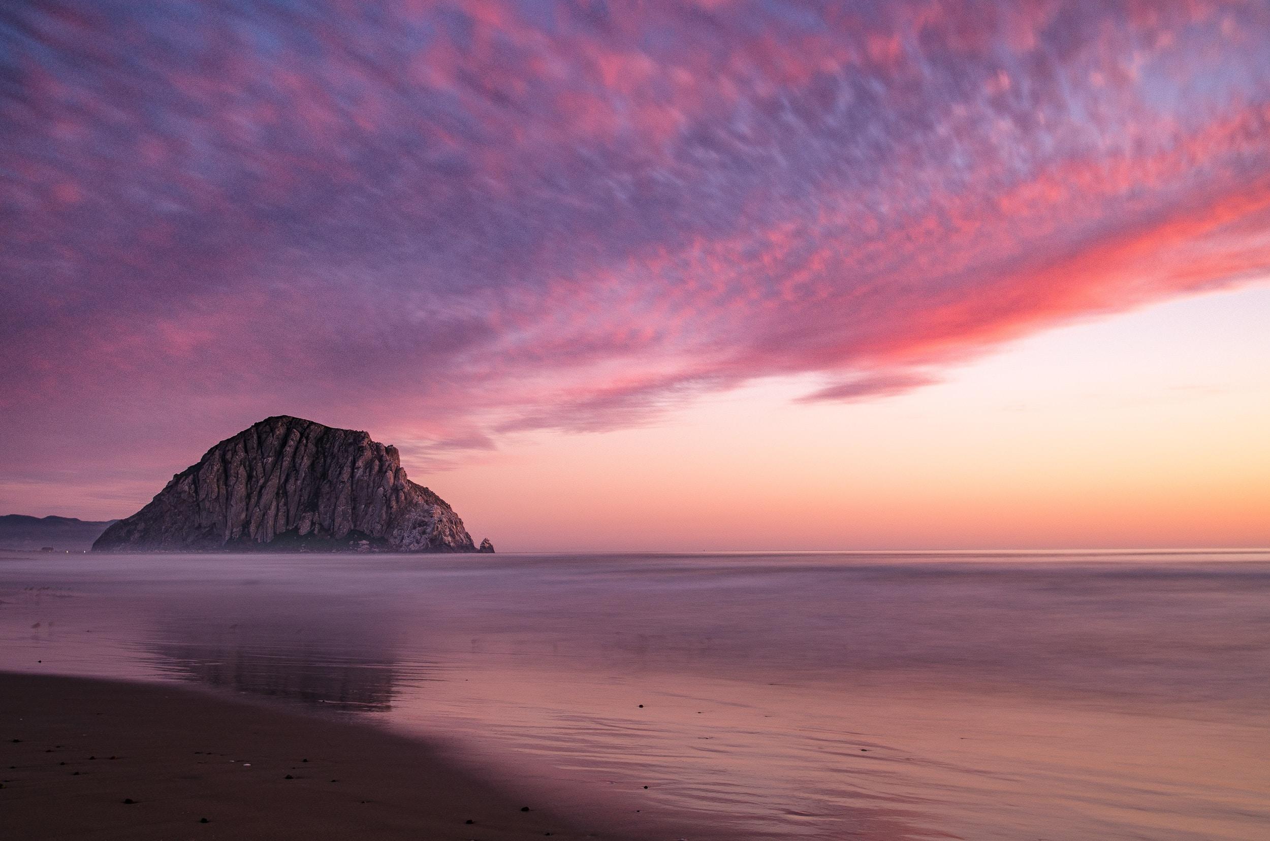 landscape photography of seashore near rock islet