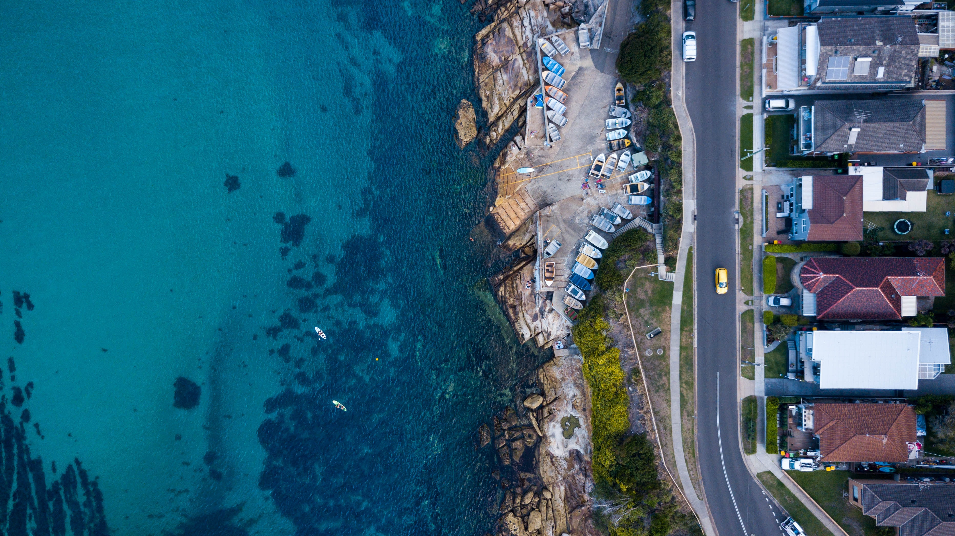 aerial photography of road near body of water at daytime